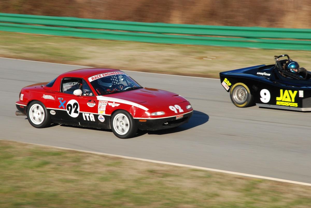 """1991 Mazda Miata """"Red""""."""