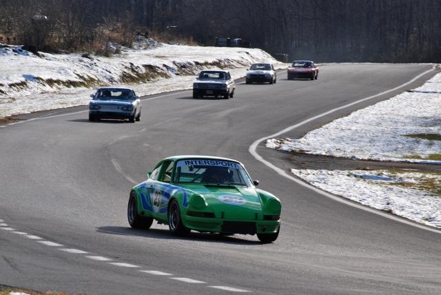 Group 3 - Alan Friedman, 1973 Porsche 911 RSR (#23) leads a pack through turn 3.