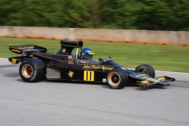 At speed up past the Esses, with the 1974 Lotus 76/1 of Andrew Beaumont (Surry, UK) #11.